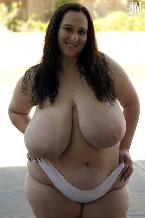 Hidden naked  with enormous jugs..