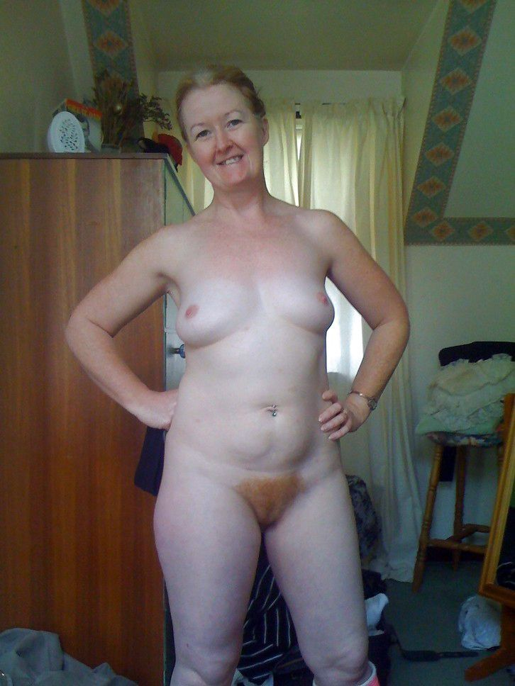 Senior lady with crimson furry muff..