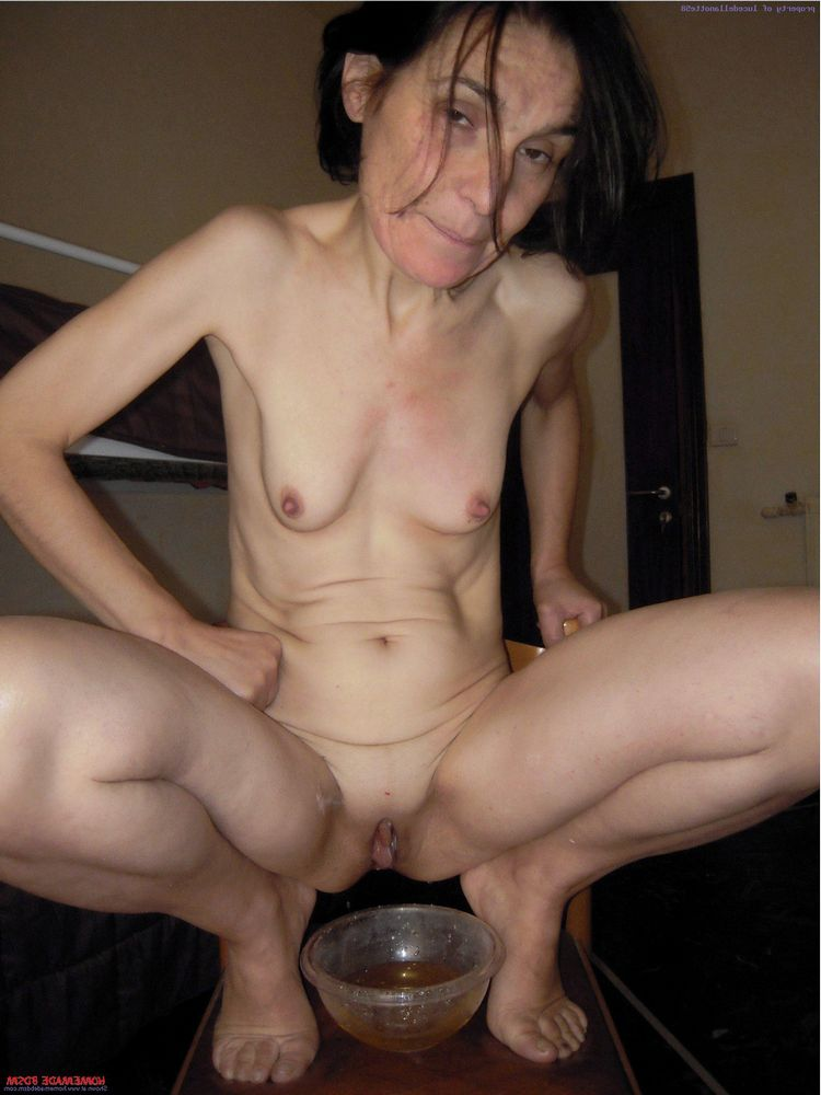 grandmother posing bare in the motel..