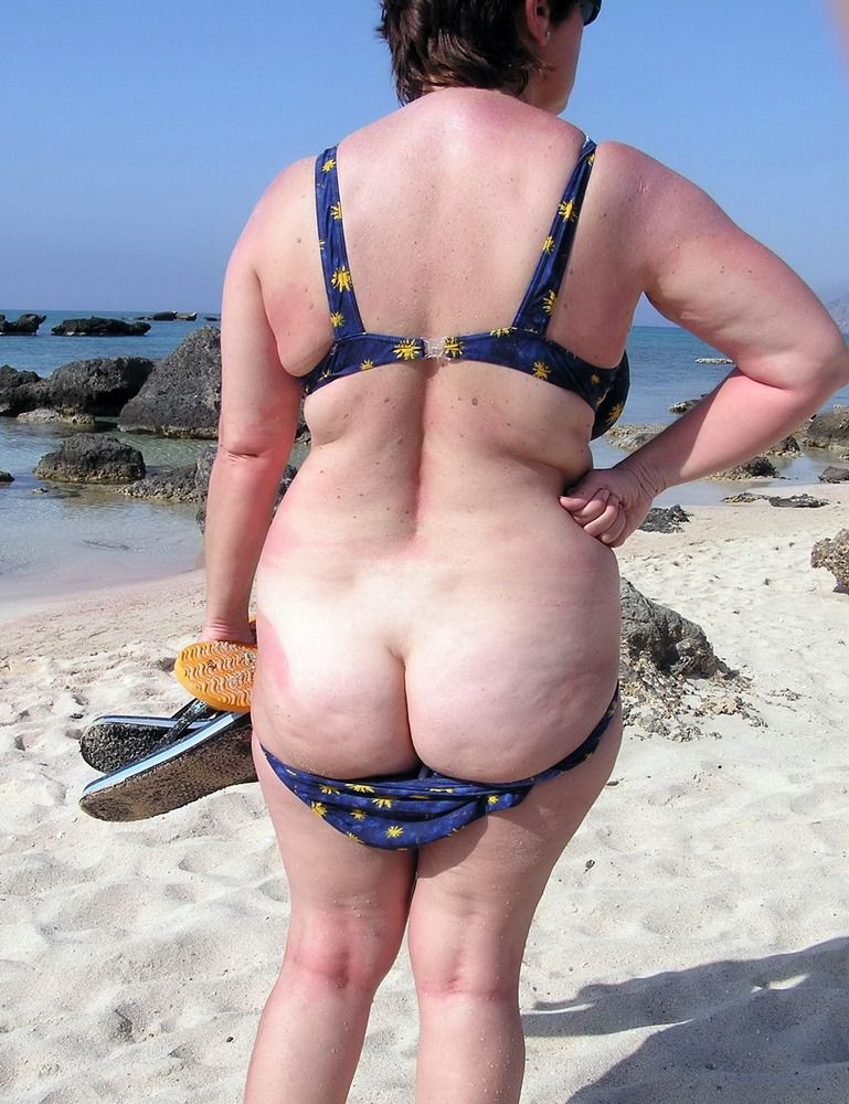 Nude elder naturist at the beach. This..