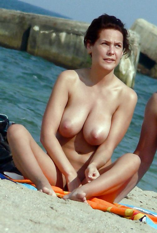 Mature nudists, vacation on a beach.