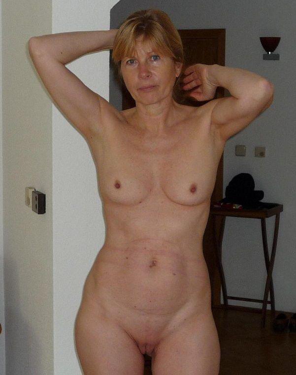 Spunky senior chick posing bare