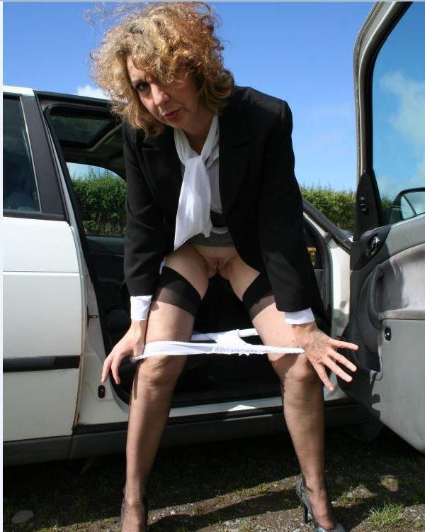 Buxom mature girls leisurely stripping..
