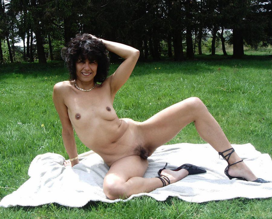 Curly black-haired  nude outdoor