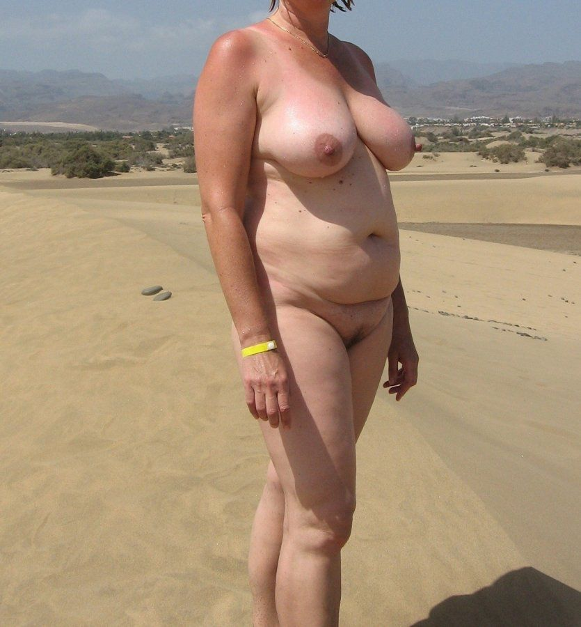 Absolutely nude shapely  in a hike