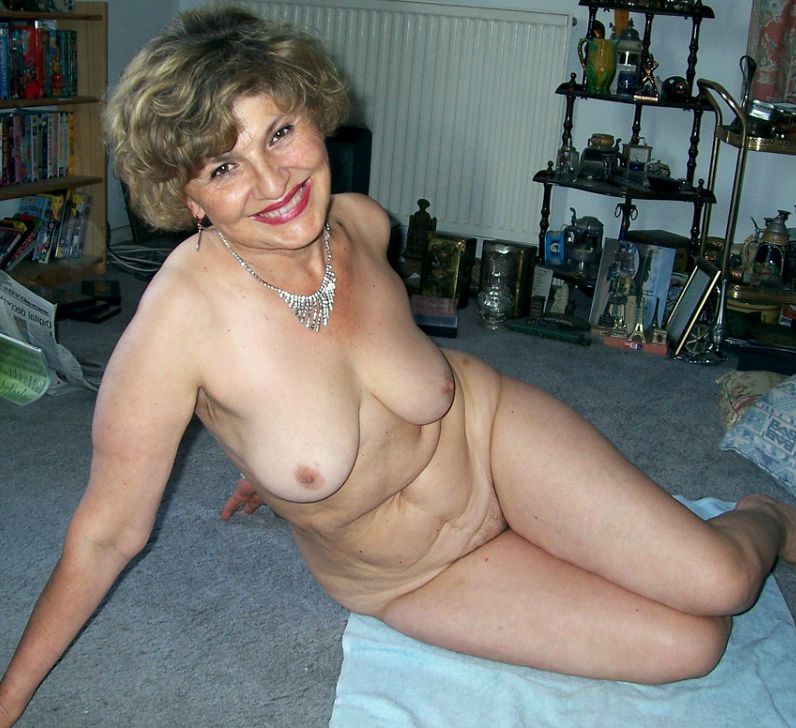 Gorgeous mature nymph homebody posing..