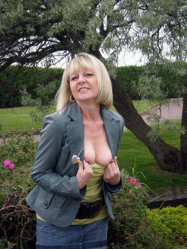 Platinum-blonde mature housewife..