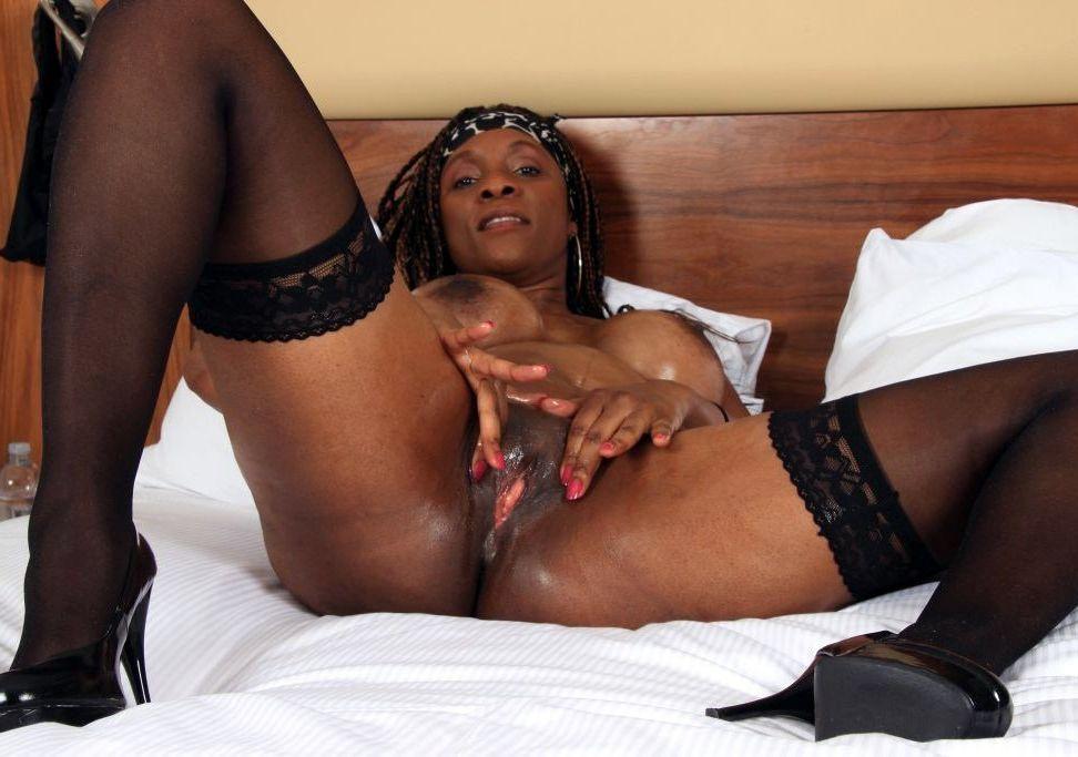 African Mummy April fondling her sleek..