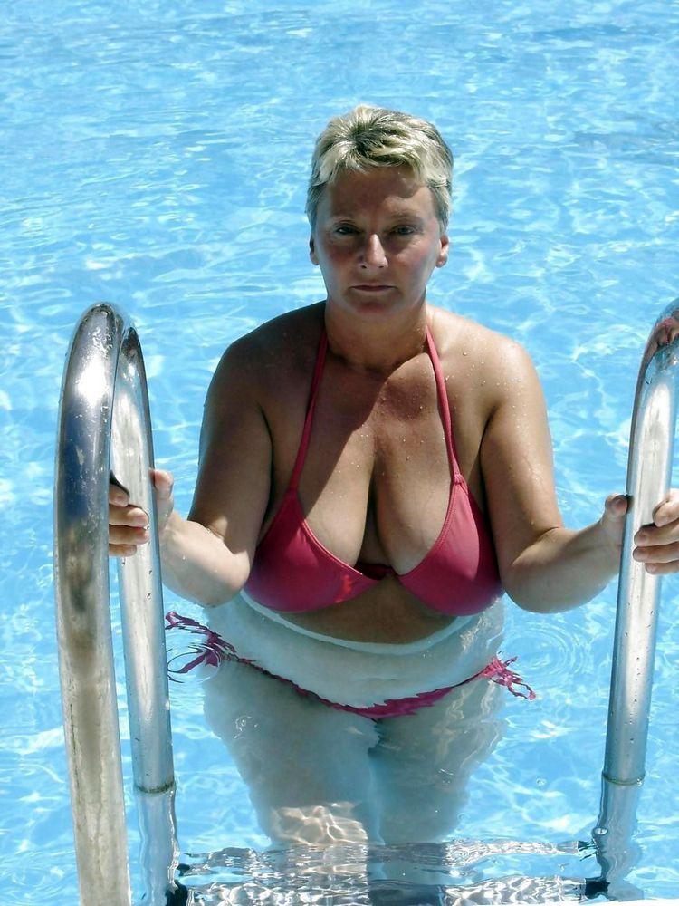 Big-chested mature femmes sunbathing..