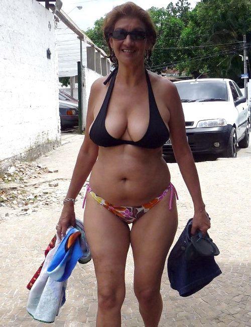 Dissolute grandma sunbathing bare on..