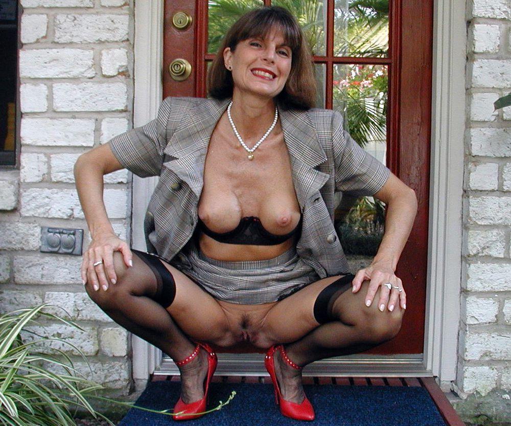Tall mature ex-teacher posing in..