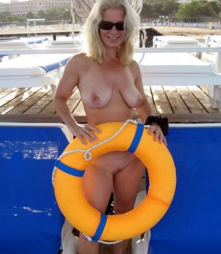 Joyful mature femmes nudists in..